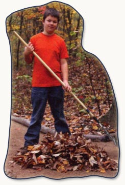 Therapeutic camper raking leaves