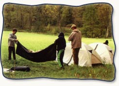 Folding up tent while therapeutic camping
