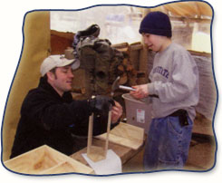 Camper and counselor in woodshop