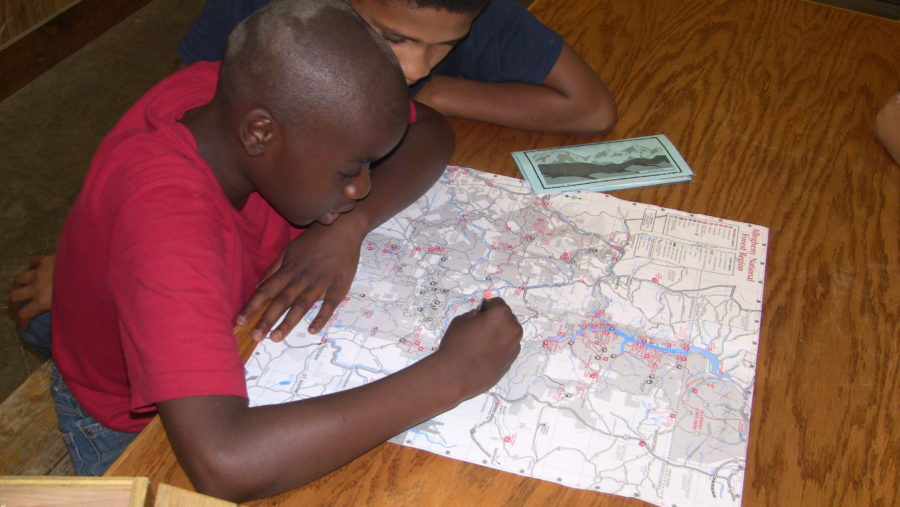 Camper studying map